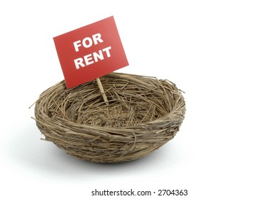 Bird nest with a for rent sign.