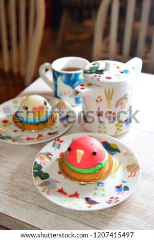 Bird Shape Cakes And Colorful Pot Plate On The Wooden Table