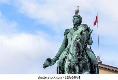Bird sitting on horseman statue