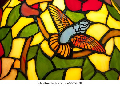 A bird in stained glass of  lamp.