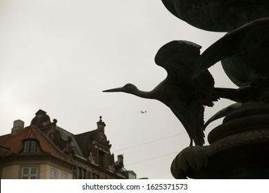 Bird Statue in Building Facade