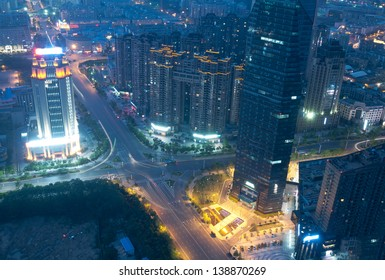 Bird view at Nanchang China. Skyscraper under construction in foreground. Bund (Nanchang) area