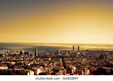 A bird view over city in sunset. Barcelona, Catalonia, Spain. Night, sunset