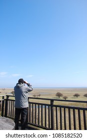 Bird watcher in a tower by the great grassland at Ottenby on the swedish island Oland - a famous birding site