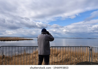 Bird watcher viewing by seaside from a platform on the island Oland in Sweden