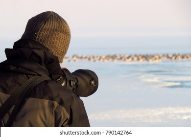Bird watching with telescope - bird watcher counting birds at IWC International waterbird census - bird count, ornithologist