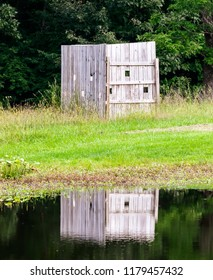 Bird watching wall with reflection on lake