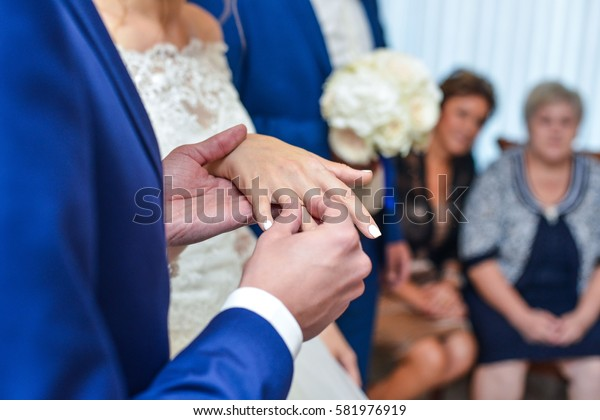 birde wears the ring on the finger of the groom