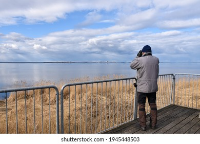 Birder observing from a platform by seaside on the island Oland in Sweden