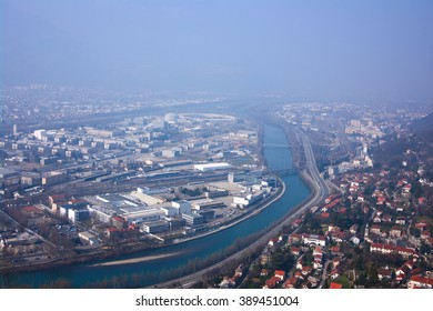 Bird-eye view on Grenoble, Isere river and ESRF laboratory facilities. Taken in March 2011.