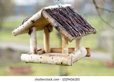 Birdhouse hangs in a garden
