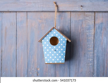 birdhouse on antique rustic wood background.