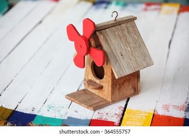 birdhouse on grunge wooden panel