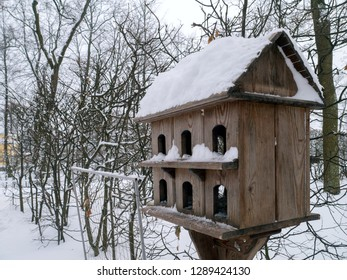 Birdhouse on pole in winter park