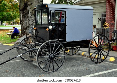 Bird-in-Hand, Pennsylvania - October 14, 2015:  Classic Amish buggy with enclosed cab parked at the Bird-in-Hand Farmer's Market