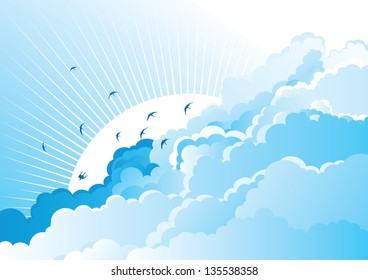 Birds in the cloudy sky. Blue  background with flying Swallows on cloudy sky.