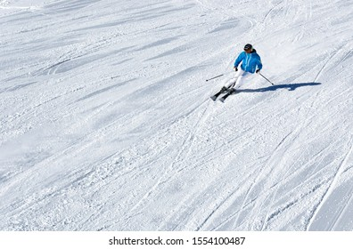 Birds ey view of a single man skiing down a slope