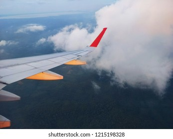 Birds eye view, Airplane view on sky,Airplane  view, Window of airplane, looking out window of airplane,On the Air looking to the ground clound Sky.