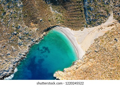 Bird's eye view of bay with beautiful beach near Sikati cave, Kalymnos island, Greece
