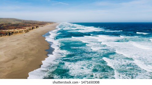 Birds eye view of beauty of wild island near Pacific ocean with sea breeze and foamy waves, aerial view of coastal landscape in California, breathtaking seaside with beautiful nature