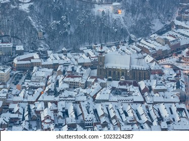Bird's eye view of the Black Church in the snow covered historic center of Brasov city, Romania.