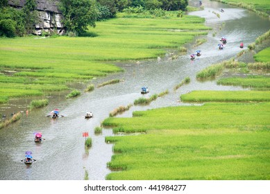 Bird's eye view of the boat excursion through rice paddies amid limestones in Tam Coc, Ninh Binh, Vietnam