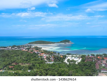 Birds eye view  Bophut beach in Koh Samui, Thailand. The scenery of seascape and bay with city and forest of coconut trees beautiful blue sky