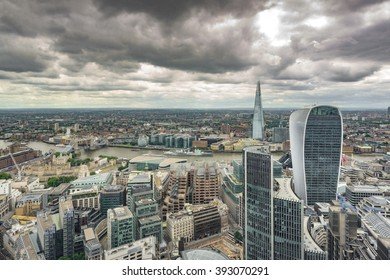 Birds eye view of the City of London on a cloudy day.