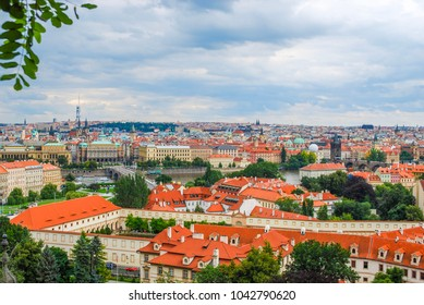 Bird's eye view of the city of Prague with the Danube river on an overcast day
