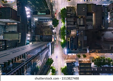 Bird's Eye View of City Streets and High Rise Skyscrapers at Night