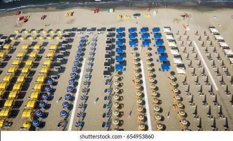Bird's eye view of colored umbrella in a beach in italy, Tuscany,Viareggio