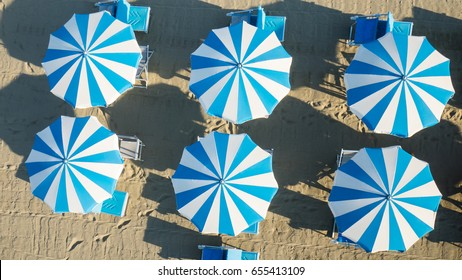 Bird's eye view of colored umbrella in a beach in italy
