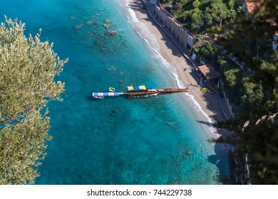 Birds Eye View of a Dock on Turquoise Sea