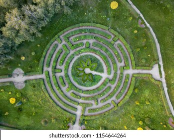 Birds eye view from the drone to a labyrinth in the Botanical garden in the summer day.