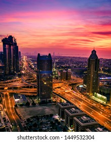 Bird's eye view of Dubai downtown buildings and Sheikh Zayed Road after sunset