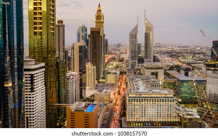 Bird's eye view of Dubai Financial District skyline and rush hour traffic at dusk
