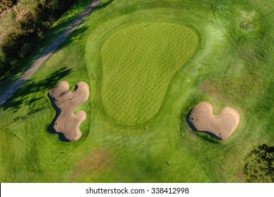 birds eye view of golf course hole green and sand traps