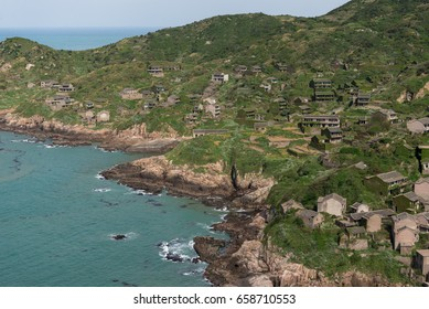 A bird's eye view of Go'qi Island, one of the Zhou'shan islands in the East China Sea, Zhe'jiang province, China. On the right are the houses abandoned for many years as locals left for better life.