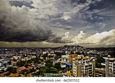 Birds eye view of Kampala skyline with storm clouds