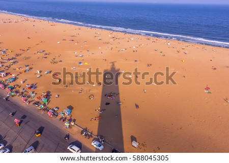 Birds eye view from light house and the shadow of light house, Marina Beach, Chennai, India. Jan 20 2016 With copy space