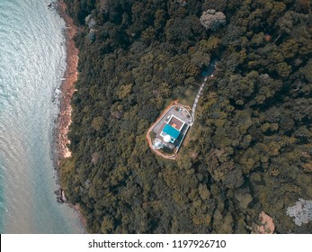 birds eye view of a lighthouse at a cape