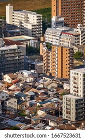 The birds eye view of modern and traditional styles of Japanese residences: the single-family detached house and the multiple-unit building in the center of Osaka city. Japan