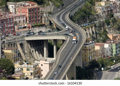 Bird's eye view of multi-level flyover in mountain city somewhere in Italy