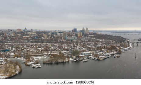Birds eye view on cityscape, skyline and coastline of Dnieper River near Dnipro city at winter time. (Dnepr, Dnepropetrovsk, Dnipropetrovsk). Ukraine