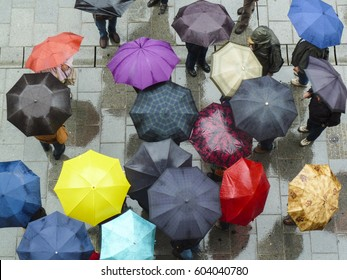 Bird's eye view on a group of people with umbrellas