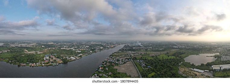 Bird's eye view Panorama, large river flows through the city, aerial view drone shot.