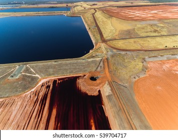 Birds Eye View of Red Tailing Ponds with Different Textures Shapes and Colors on a Sunny Day