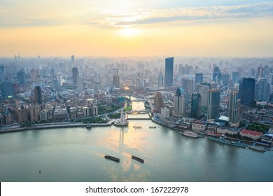 a bird's eye view of shanghai and huangpu river in sunset