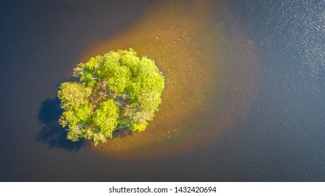 Birds eye view to small island on a sunny day on Nasijarvi lake, Tampere Finland