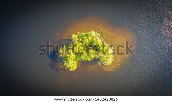 Birds eye view to small island on a sunny summer day on Nasijarvi lake, Tampere Finland